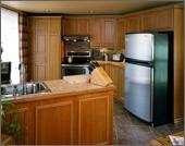 Armoires de cuisine de mélamine et ajout de moulures avec faux fini bambou